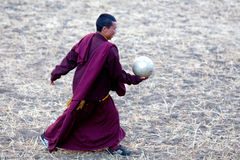 Buddhist monk playing soccer Royalty Free Stock Images