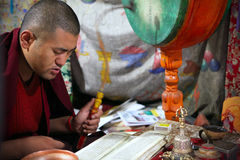 Buddhist monk pray. During the morning ceremony on September 4, 2011 in  Thiksey Gompa, Ladakh, India Stock Photography