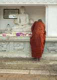 Buddhist monk praying Royalty Free Stock Photos
