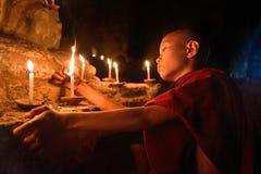 Buddhist monk praying stock image