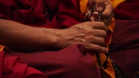 Buddhist monk praying - hands and beads rosary stock video
