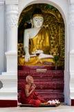 BUDDHIST MONK PRAYING AT SHWEDAGON PAGODA. Shwedagon Pagoda, Yangon, Myanmar - Oct 21, 2017: The sacred golden pagoda that symbolize the spiritual bond to all Royalty Free Stock Photos