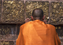 Buddhist monk prays at the Dhamekh Stupa. stock image