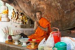 Buddhist monk prays Stock Photography