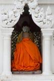 A Buddhist monk prays at Shwedagon Pagoda, Yangon, Myanmar Royalty Free Stock Images