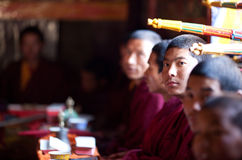 Buddhist monk during puja ceremony Stock Photos