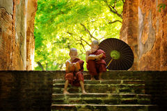 Buddhist Monk Reading Outdoors Royalty Free Stock Photography