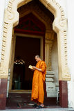 Buddhist Monk reading prayer book Royalty Free Stock Photos