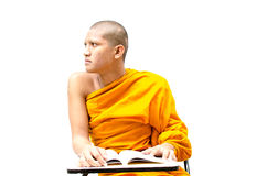 Buddhist monk reading a religious text. Royalty Free Stock Photos