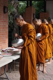 Buddhist monk receives food to eat Royalty Free Stock Photography
