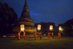 Buddhist monk release traditional lanterns to the Buddha. Royalty Free Stock Photos