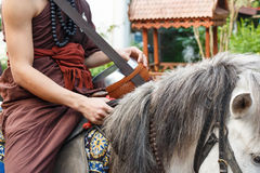 Buddhist monk ride horse Royalty Free Stock Photography