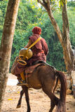 Buddhist monk ride horse Stock Image