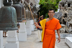 Buddhist monk ringing bells. Buddhist Thai monk ringing bells during a ceremony Stock Images