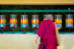 Buddhist monk rotating prayer wheels Royalty Free Stock Photos