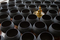 Buddhist monk's alms bowl. Offerings in a Buddhist monk's alms bowl royalty free stock photos