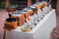 Alms. Bowl of monk in Buddhism. Religion Concept in Thai Traditional Event. Buddhist monk`s alms bowl in row line for food offering in Thai culture at wedding stock photos