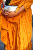 Buddhist monk's alms bowl , Thailand. Buddhist monks carrying alms round out the morning royalty free stock photo