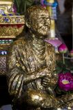 Buddhist monk's statue. A statue of buddhist monk. Wat Saket interior. Bangkok, Thailand Royalty Free Stock Photo