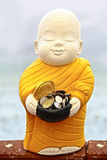 Buddhist monk sculpture for receive food money Royalty Free Stock Images