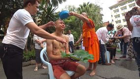 Buddhist monk shaving the head of a boy to prepare him for novice. A Buddhist monk shaving the head of a boy to prepare him for novice. The Ordination Ceremony stock video footage