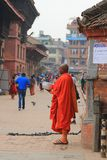 A Buddhist monk standing in the Durbar Square Stock Photo