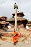 A buddhist monk standing in Hanuman Dhoka Square Stock Photography
