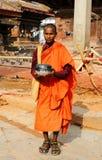 A buddhist monk standing in Hanuman Dhoka Square Stock Photos
