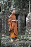 Buddhist Monk Stands at Old Temple of Angkor Cambodia Royalty Free Stock Images