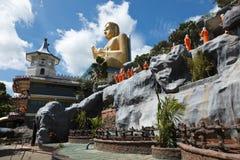 Buddhist monk statues. Going to Gold Buddha temple, Dambulla, Sri Lanka Royalty Free Stock Images