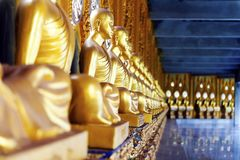 Buddhist monk statues at a cloister of Phra Maha Chedi, Roi Et, Thailand Royalty Free Stock Photos