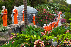 Buddhist monk statues going to Gold Buddha temple, Dambulla, Sri Royalty Free Stock Image