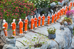 Buddhist monk statues going to Gold Buddha temple, Dambulla, Sri Stock Images