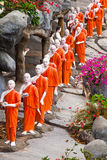 Buddhist monk statues going to Gold Buddha temple, Dambulla, Sri Stock Image