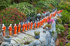 Buddhist monk statues. Going to Golden Temple of Dambulla in Sri Lanka Stock Image
