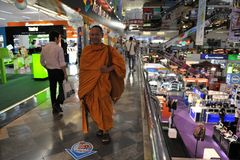 Buddhist Monk in an IT Store Royalty Free Stock Photo