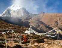 Buddhist monk stupa prayer flags near Pangboche monastery Stock Photography