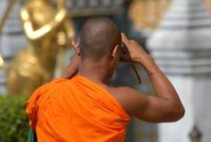 Buddhist Monk Taking a Photo Stock Image