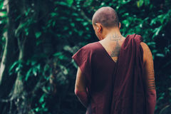 Buddhist monk with tattoo on his back
