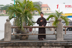 Buddhist monk at the Thu Thiem Ferry‎. Saigon (Ho Chi Minh), Vietnam Stock Photos