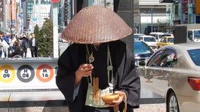 Buddhist monk, Tokyo, Japan. Buddhist monk in Ginza in Tokyo stock footage