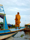 Buddhist monk, Tonle Sap Lake. A Buddhist monk riding a local boat on Tonle Sap lake in Cambodia Stock Photography