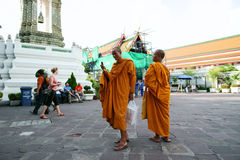 Buddhist Monk using cell phone at Wat Pho Stock Photo