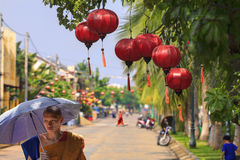 Buddhist Monk. A buddhist monk in Vietnam protects himself from the hot sun the streets of the city Hoi an Stock Photography