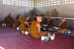 Buddhist monk is waiting for breakfast given by people who want Royalty Free Stock Image