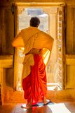 Buddhist monk in a door royalty free stock photo