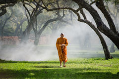 Buddhist monk walk receive food in the morning Royalty Free Stock Photo