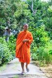 Buddhist Monk Walking To The Camera Royalty Free Stock Photo