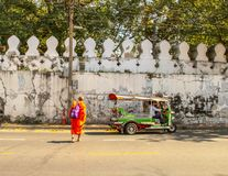 Buddhist monk walking to the temple in Ayutthaya Bangkok, Thailand royalty free stock image