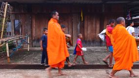 Buddhist monk walks in the morning stock video